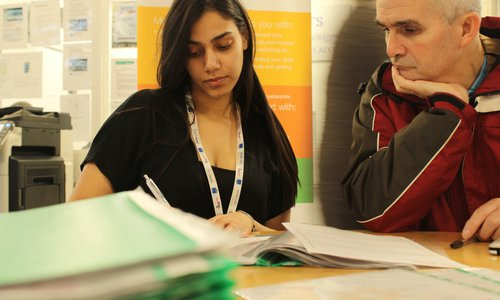A member of the LCC team working with a WiLL participant.