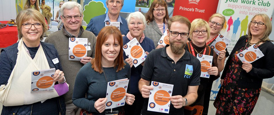 All partners at the project launch holding Work Live Leicestershire leaflets.